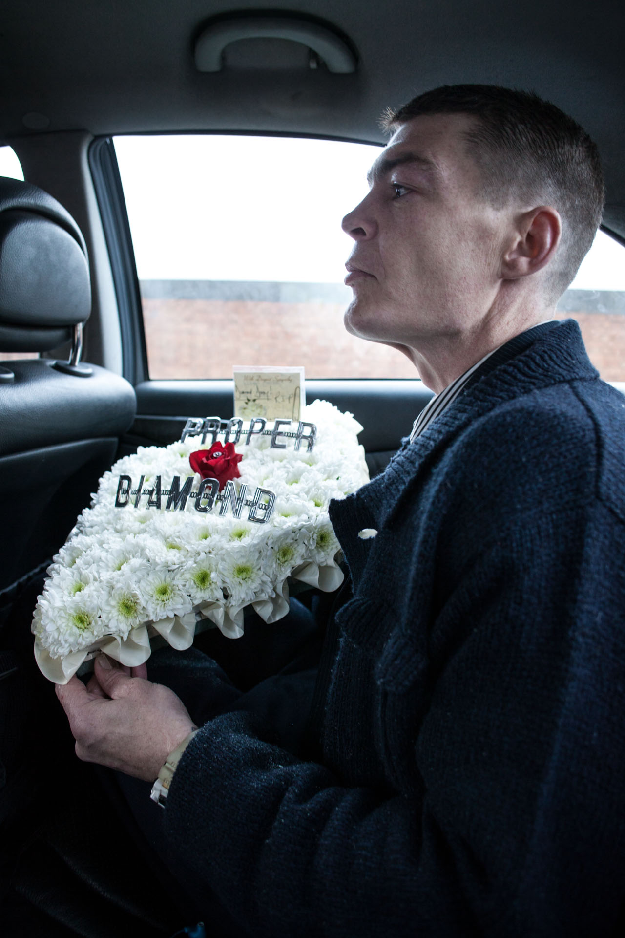 Mourner at funeral of Danny Woollard, East End gangster