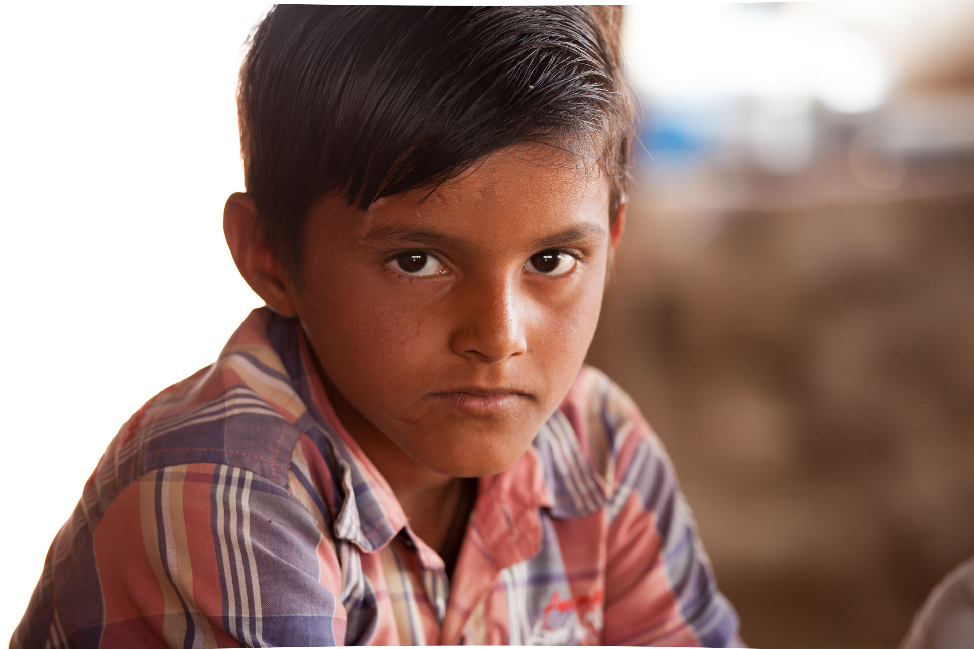 Arjun, brick kiln boy, Gujarat, India. © Crispin Hughes