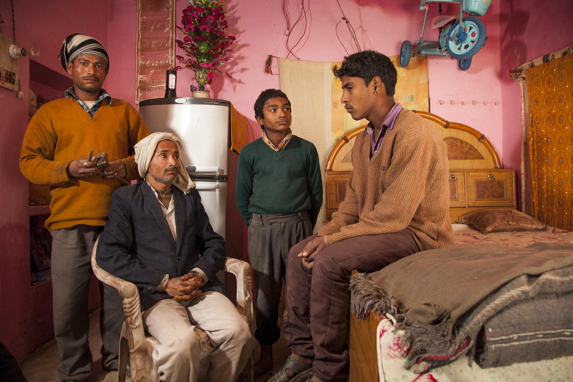 Madhupur Village near Agra, Uttar Pradesh, India.Harish and his family.Mahender, his father Daudayal, Luekush (12) and Harish in Mahender and Ruby's beautiful bedroom.