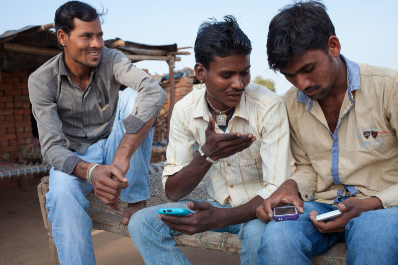 Mobile phones, India, ©Crispin Hughes