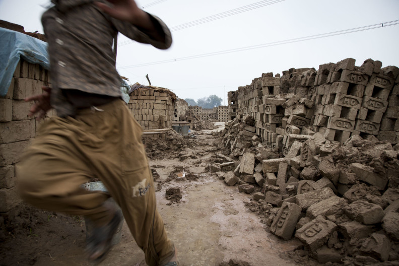 Donketys in India. Brick kilns. Rain turns bricks to mush